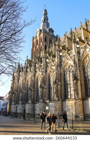 Den Bosch, Netherlands - January 17, 2015: People near the cathedral in  Dutch city of Den Bosch. Netherlands - stock photo