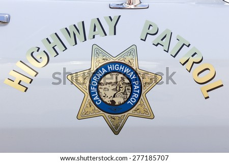 DEN BOSCH, NETHERLANDS - MAY 10, 2015: California Highway Patrol sign on a vintage US police car. - stock photo