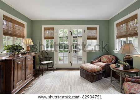 Den in suburban home with doors to patio - stock photo