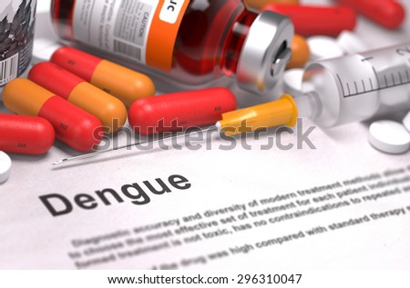 Dengue - Printed Diagnosis with Red Pills, Injections and Syringe. Medical Concept with Selective Focus. - stock photo
