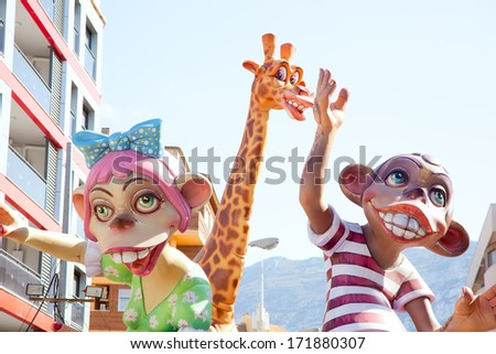 DENIA, ALICANTE, SPAIN - MARCH 18, 2012: Fallas is a popular fest with humor figures on streets that will burn in March 19 night in Valencia and also Denia in Valencia Province, Spain, March 2012. - stock photo