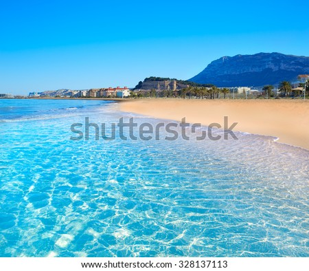 Denia beach in Alicante in blue Mediterranean with Montgo Alicante - stock photo