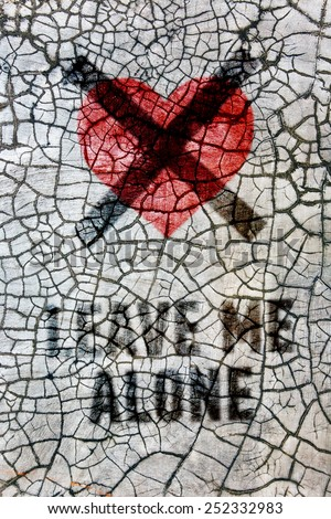 Denial of the holiday Valentine's Day: crossed heart with the words: Leave me alone! - stock photo