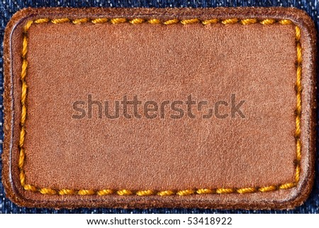 Denim background with blank label - stock photo