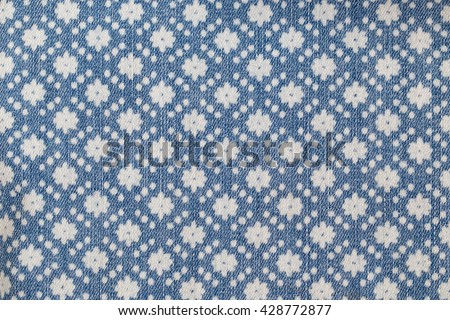 Denim  blue jeans with flower stamp print, fashion background - stock photo