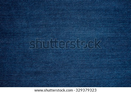 Denim fabric texture ideal for background, closeup of jeans - stock photo