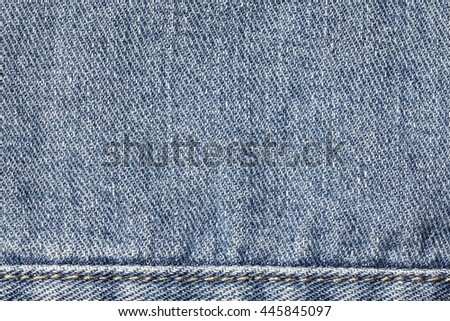 Denim jeans texture background with seam of fashion jeans design with copy space for text or image. - stock photo
