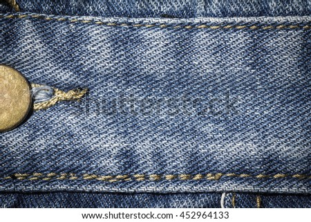 Denim jeans texture or denim jeans background with seam and studs of fashion jeans design with copy space for text or image. Dark edged. - stock photo
