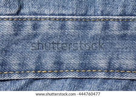Denim jeans texture or denim jeans background with seam. Old grunge vintage denim jeans fashion design. - stock photo