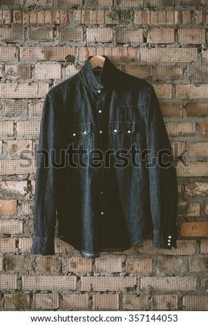 denim shirt on the brick background - stock photo