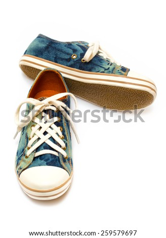 denim sneakers on a white background - stock photo