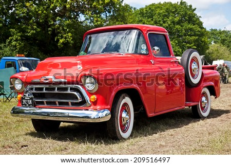 DENMEAD, UK - MAY 25: An American pickup truck stands on static display for the public at the Overlord show on May 25, 2014 in Denmead - stock photo