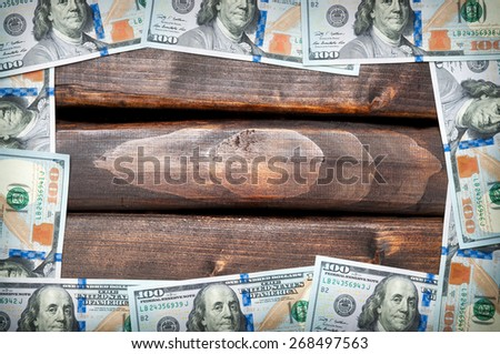 Denominations of American hundred dollar bills on a background of old boards. American dollar. Grange background. - stock photo
