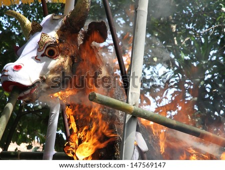 DENPASAR, INDONESIA - MAY 12:  A closeup of the white bull's head used as a sarcophagus burning during a Balinese Ngaben or cremation ceremony in Ubud, Denpasar, Bali, Indonesia on May 12, 2013. - stock photo