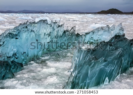 Dense, green amorphus glacial ice floating in Laguna San Rafael near the San Rafael Glacier in  in the Northern Patagonian Ice Field in southern Chile, South America.  - stock photo