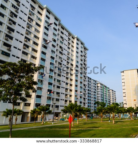 Dense of HDB housing flats with sun drying hanging clothes line in Singapore at sunset with warm and soft light. Urban concept. Panoramic style - stock photo