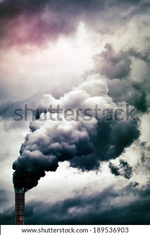 Dense smoke emission from factory pipe - stock photo