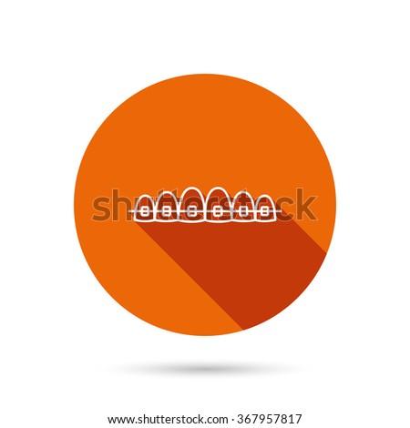 Dental braces icon. Teeth healthcare sign. Orthodontic symbol. Round orange web button with shadow. - stock photo
