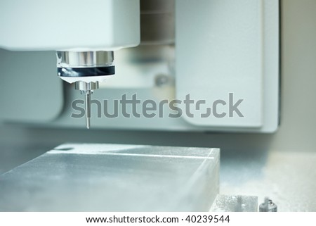 Dental CAD CAM with drill unit in a lab - stock photo