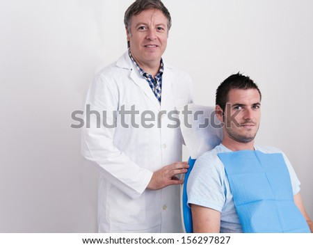 Dental Clinic. Portrait of the dentist and his patient - stock photo