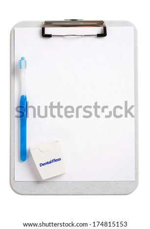 Dental: Clipboard with Blank Paper and Toothbrush - stock photo
