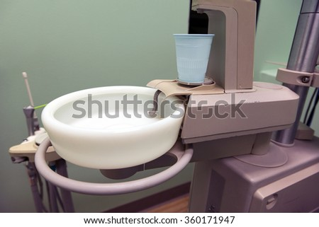 Dental cuspidor used for patients when they have to rinse. - stock photo