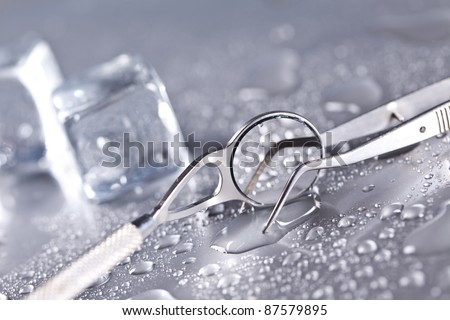 Dental equipment and water drops - stock photo