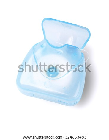 Dental Floss in Plastic Container on White Background - stock photo