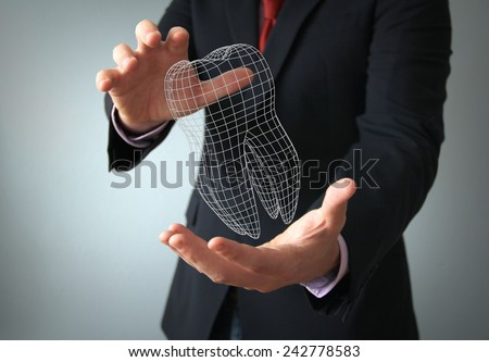 dental implant design concept: 3d tooth wire on a businessman hands - stock photo