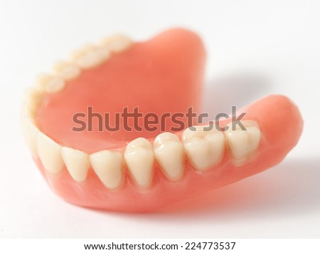 Dental plate making of in the lab - stock photo