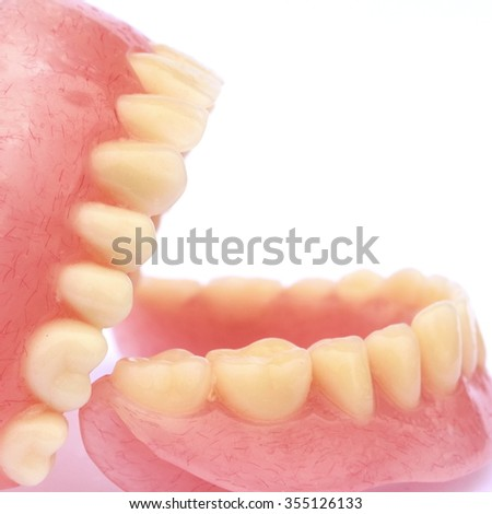 Dental prosthetic isolated in white - stock photo