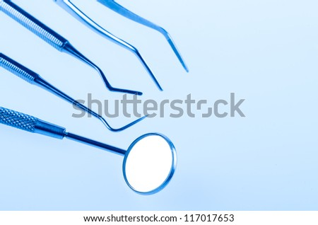 Dental tools and equipment over blue background - stock photo