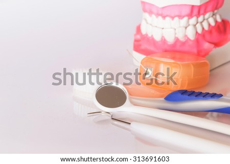 Dental tools set and teeth model on white background.Medical concept. - stock photo