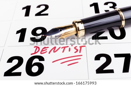 Dentist appointment marked n calendar with  fountain pen - stock photo