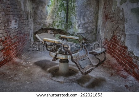 Dentist Chair in a Cell in Eastern State Penitentiary, Philadelphia, Pennsylvania - stock photo