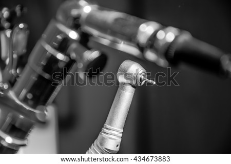 Dentist drill instrument in a dental office - stock photo