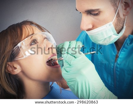 Dentist effects a cleaning of the teeth - stock photo