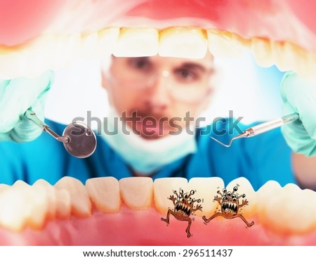 Dentist in a oral visit sees germs - stock photo