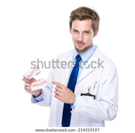 Dentist show with denture - stock photo