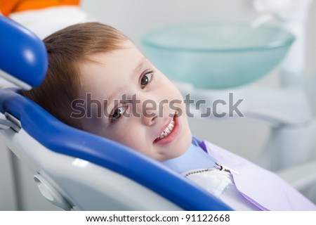 dentist treats tooth intern at the boy - stock photo