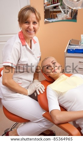 Dentist with a happy patient. - stock photo