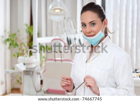 dentist with equipment standing in office - stock photo