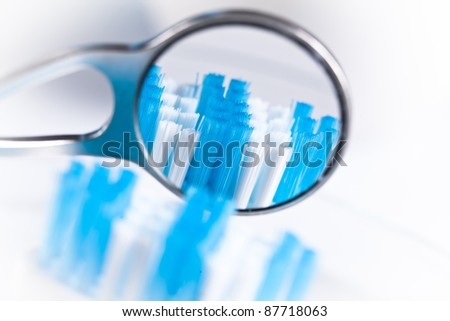 dentistry mirrow and toothbrush - stock photo