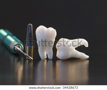 Dentistry. Wisdom teeth, implant and dental tools - stock photo