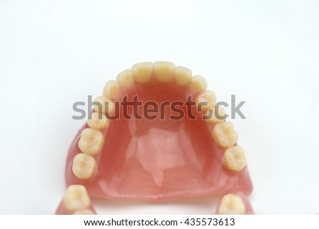 Dentures made of plastic on a white background - stock photo