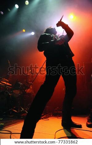 DENVERAPRIL 21:Vocalist Rick DeJesus of the Heavy Metal band Adelitas Way performs in concert April 21, 2011 at the Ogden Theater in Denver, CO. - stock photo