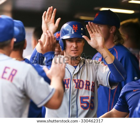 DENVER-AUG 21: New York Mets infielder Kelly Johnson in the dugout with teammates during a game against the Colorado Rockies at Coors Field on August 21, 2015 in Denver, Colorado. - stock photo