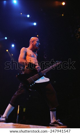 DENVERAUGUST 22:Bassist Shavo Odadijian of the Heavy Metal band System of a Down performs in concert August 22, 2002 at the Pepsi Center in Denver, CO.  - stock photo