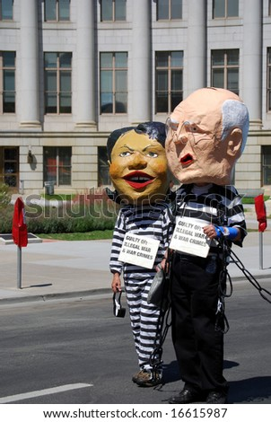 DENVER – AUGUST 26: Demonstrators posing as Secretary of State Condoleezza Rice and Vice President Dick Cheney walk along a street during the Democratic National Convention August 26, 2008 in Denver. - stock photo