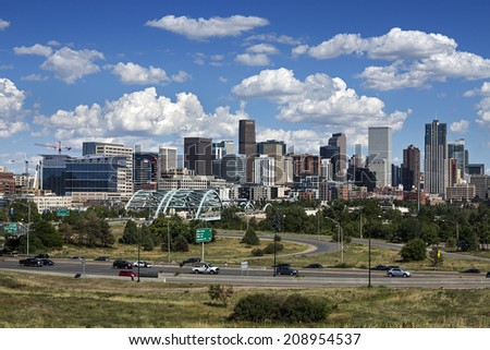DENVER, COLORADO  AUG. 2, 2014: Denver skyline at Sunny Day. Denver is the capital of Colorado also has nicknamed the Mile-High City because the elevation is exactly one mile above sea level. - stock photo